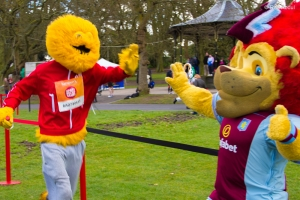 High-five Honey monster to Aston Villa Mascot